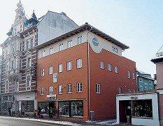 Aufstockung eines Geschäftshauses in Rosenheim