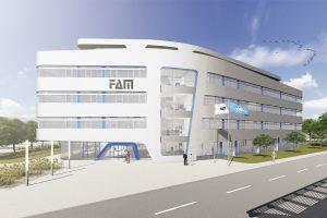 Die futuristische Gebäudeform des Neubaus wird durch eine moderne Fassade aus großformatigen silbergrauen Verbundplatten unterstrichen.