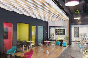 Eine nette Ruhezone am Rande eines Korridors mit den neuen Akustikbaffeln Armstrong Baffles Curves