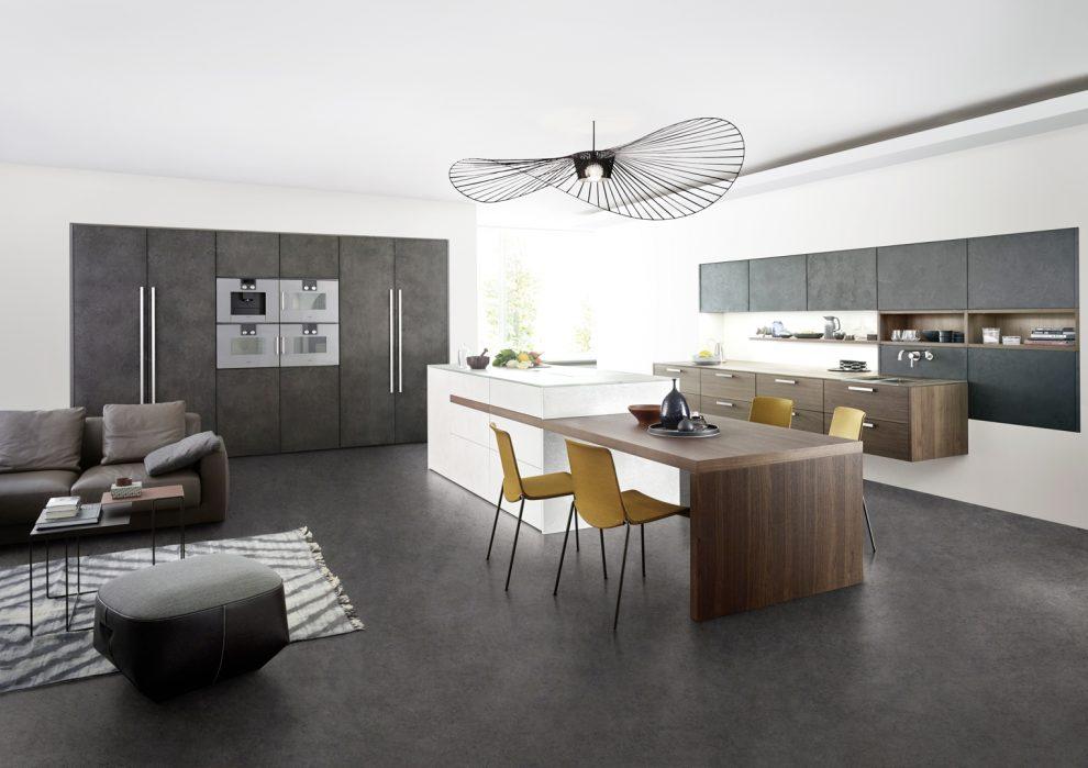 Die Neu Gestaltete Insel Der Küche Concrete Integriert Einen Esstisch In  Form Einer Seitlich Auskragenden Platte. Eine Elegante Und Kompakte Lösung.
